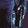 hasthehighground: hand on his holstered handgun ([tool] handgun)