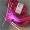 ambersweet: Hardcore knitters do it with DPNs. (Pink sock)