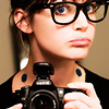 recessional: a dorky-looking young woman with huge glasses and a camera (personal; i am indeed a dorkface)