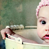 recessional: a baby in a bucket, looking amazed (personal; woah. srsly.)