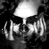 seeitbloom: black and white; person's face resting in her hands, and the face is blended with a skull image (Default)