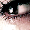 seeitbloom: close-up of an eye and eyelashes with tears welling up and seen falling from the eye (& it all wells up)