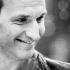 gallifrey_times: Black and white photo of Nine smiling (dw-still-bw-brilliant by casett)