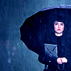 frith_in_thorns: Mako Mori with an umbrella above her head in the rain (PR Mako Mori)