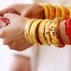 signifier: hands with many gold bracelets (Ethala: Ada (Held in Love and Pleasure))