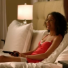 bellchronicles: a black woman sitting in a couch, smiling happily (undercovers recline smile)