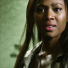 st_aurafina: A black woman in a sheriff's uniform, she looks surprised and amazed (Sleepy Hollow: Abbie)