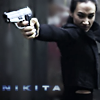 copracat: Nikita pointing a very large gun (nikita)