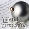 "krait: silver Christmas ornament, with text ""Yuletide Treasure"" (yuletide treasure)"