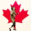 ajnabieh: Robin Sparkles (character from How I Met Your Mother) in front of a red maple leaf, dancing. (canada sparkles)