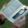 jesse_the_k: Hands open print book with right side hollowed out to hole iPod (Alt format reader)
