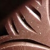 rydra_wong: Close-up of the moulded design on a bar of Grenada Chocolate Company chocolate. (food -- grenada chocolate)