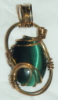 jemyl: green catseye cabachon in brass (greenbrass)