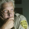 ducened: Face of a man in a sheriff's uniform, chin in hand. (listening)