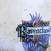 notemily: Symbol of Ravenclaw House from Harry Potter, a bronze eagle against a blue shield. (hp - ravenclaw)