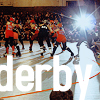 glinda: roller derby girls on track with lens flare (roller derby)