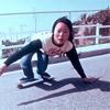 exchangediary: color photo of peggy oki skateboarding (Peggy Oki)