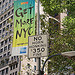 "tree_and_leaf: View of lower Manhattan: sign reading ""No horn honking, $350 fine"" in front of banner reading ""get more NYC"". (new york optimism)"