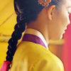 amihan: medium shot of shin min ah as arang in 'arang & the magistrate', long hair in a braid, dressed in yellow hanbok ([arang & the magistrate] arang braid)