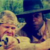 delphi: Screenshot from the Magnificent Seven television show of Josiah aiming a gun with Nathan beside him. (josiah/nathan)