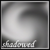 silveraspen: swirl of gray shadows with caption (shadowed)