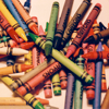 rainfall: A chaotic pile of generic crayons. All the colors of a child's rainbow. (crayons)