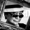 grey_gazania: a black-and-white photo of yoko ono looking through an empty picture frame (the person who's sitting inside is you)