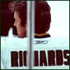 highlander_ii: hockey player Brad Richards' back through the glass around the ice ([hockey] Brad Richards - 2010)
