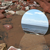 the_rck: mirror on a beach in shallow water, reflecting the sky ()