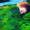 mjules: A red-headed child sleeping in a bed that is patterned like green fields. (I made my bed like a mountain range)