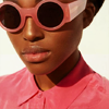 amihan: close-up of a model wearing a pink top and sunglasses with pink frames ([fashion] pink)