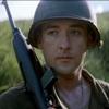 hecu_marine: John Cusack in WW II US Army fatigues and helmet, holding a rifle, looking unimpressed (carbine)