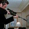 hecu_marine: John Cusack in a black suit, looking down the scope of a sniper rifle in an apartment or hotel room (sniper rifle)
