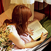 darwin: A redheaded girl wearing a book. (Escape into words.)