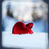 fallingtowers: heart-shaped red tree ornament in snow (Seasonal 2)