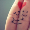 foxfirefey: A picture of a hand where inked stick figures hug across fingers with a heart above them. (hearts)