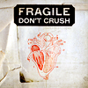 meloukhia: A drawing of a human heart. 'Fragile, do not crush' is stenciled above. (Fragile)