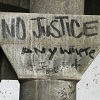meloukhia: Graffiti reads 'no justice anywhere' (No justice)