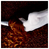 meloukhia: A person lying down, back to the camera, with long reddish hair streaming across the ground (Lying down)