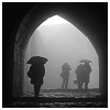 meloukhia: An archway, surrounded by mist, with people in umbrellas in the background (Misty day)