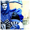 meloukhia: A person dressed in blue and wrapped in elaborate layers of blue fabric (Blue person)