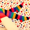meloukhia: A pair of legs in stripy socks, waving gleefully against polkadot wallpaper (Stripy socks)
