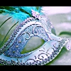 serenityrapture: A blue masquerade mask with silver filigree and a bright teal feather. (Default)