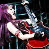 scaramouche: Ruby Lewis as Scaramouche playing a Red Gibson guitar. (scaramouche hits the riffs)