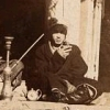 onewhitecrow: young 19th century Khazak man holding tea cup beside teapot and hookah (tea)