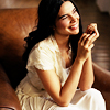 cnm_ray_j: Zuleikha Robinson - a woman with dark hair and tanned skin wearing a white dress (Ray - femme)