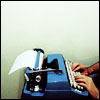 elaineofshalott: Two hands on a deep-blue typewriter. (selectric blue)