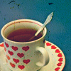 elaineofshalott: Aged photo of a white tea-mug with red hearts, sitting on a matching saucer. (<3 tea)
