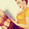 elaineofshalott: Pin-up girl drawing of woman with garters showing, reading a book and licking her index finger to turn the page. (bookworm)