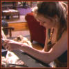 brightknightie: Tessa working with a chisel tool at her desk in the barge (Other Fandom HL Tessa)